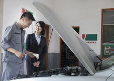 Mechanic Chatting and Laughing with Customer Royalty Free Stock Photos