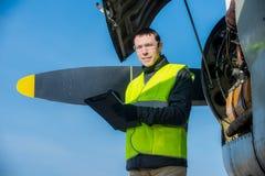 Mechanic checking airplane's engine royalty free stock photos
