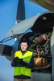 Mechanic checking airplane's engine royalty free stock image