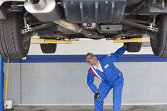 Mechanic checking the car at automobile repair shop Royalty Free Stock Photo