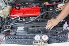 Mechanic Checking Car Engine Stock Photos