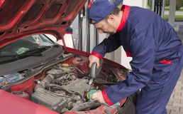 Mechanic Checking Engine Royalty Free Stock Photo