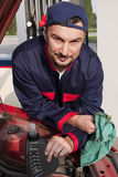Mechanic Checking Engine Stock Images