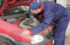 Mechanic Checking Engine Royalty Free Stock Photography