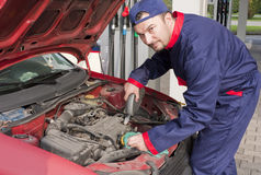 Mechanic Checking Engine Stock Photos