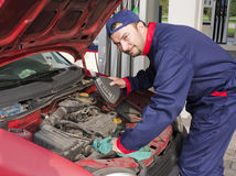Mechanic Checking Engine Stock Photography