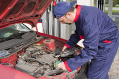 Mechanic Checking Engine Royalty Free Stock Image