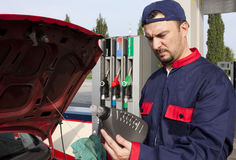 Mechanic Checking Engine Royalty Free Stock Images