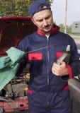 Mechanic Checking Engine Royalty Free Stock Image
