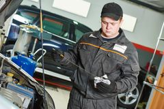 Mechanic checking oil level in automobile Stock Photo