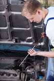Mechanic checking oil level Royalty Free Stock Photography