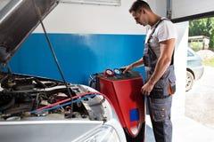 Mechanic checks the air conditioner Stock Image