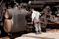 Mechanic checks locomotive Stock Images