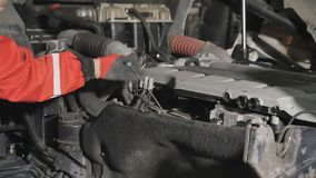 Mechanic checks the oil level of engine