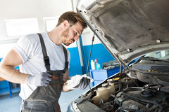 Mechanic checks the oil Stock Photography