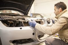 The mechanic works in the workshop royalty free stock images