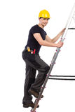Mechanic climbing a ladder. Royalty Free Stock Photos