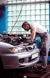 Mechanic conducting car inspection Royalty Free Stock Images