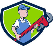 Mechanic Cradling Pipe Wrench Crest Cartoon. Illustration of a mechanic cradling holding giant pipe wrench looking to the side viewed from front set inside vector illustration