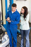 Mechanic and customer standing together Stock Photo