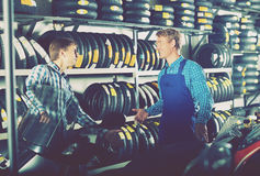 Mechanic and customer talking about motorbike Royalty Free Stock Photo