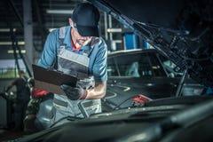 Mechanic Detailed Inspection. Car Mechanic Detailed Vehicle Inspection. Auto Service Center Theme stock photo