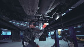 Mechanic diagnosing car with VR camera stock video footage