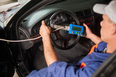 Mechanic diagnosis of the steering in auto repair service royalty free stock photo