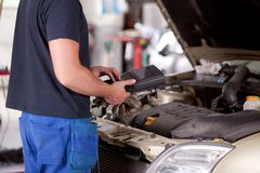 Mechanic with Diagnostic Equipment Stock Photo