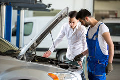 Mechanic discussing with customer Royalty Free Stock Images