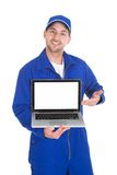 Mechanic displaying laptop over white background Royalty Free Stock Photography