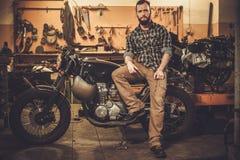 Mechanic doing lathe work in motorcycle customs garage Stock Photo