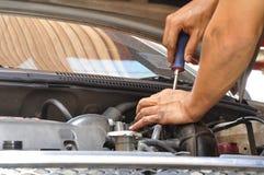 Mechanic doing unscrew Royalty Free Stock Photos