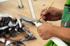 Mechanic on duty. Mechanical engineer is measuring a work piece Stock Photo