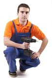 Mechanic and electric drill Royalty Free Stock Photos