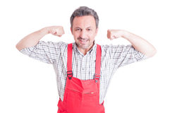 Mechanic, electrician or plumber acting strong and powerful Royalty Free Stock Image