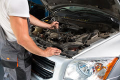 Mechanic engine repair Royalty Free Stock Photography