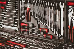 Mechanic essential instruments wrench tools. Mechanic essential instruments. Closeup of chrome wrench tools organized in box stock images