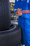 Mechanic examine the tires condition Stock Images