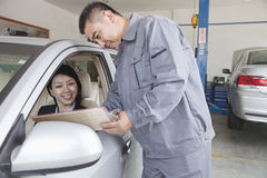 Mechanic Explaining to Businesswoman Royalty Free Stock Photography