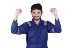 Mechanic expressing his success in studio Stock Image