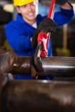 Mechanic fasten pipe Stock Images