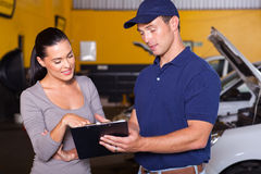 Mechanic female customer Stock Image