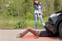 Mechanic and female driver at a roadside breakdown Stock Image