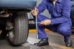 Mechanic Fix Car Tire With Rim Wrench Stock Images