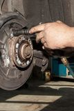 Mechanic fixes brakes Royalty Free Stock Images