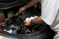 The mechanic fixes Stock Photos