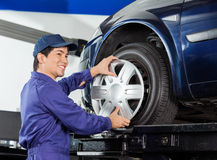 Mechanic Fixing Alloy To Car Tire Stock Photography