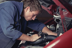 Mechanic fixing auto in car service Stock Photos