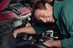 Mechanic fixing auto in car service Royalty Free Stock Photography
